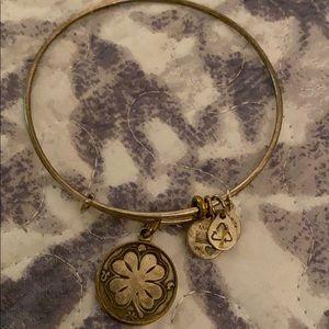 Good ALEX and ANI bracelet with four leaf clover .